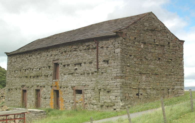 Lower view of stone bank barn in England