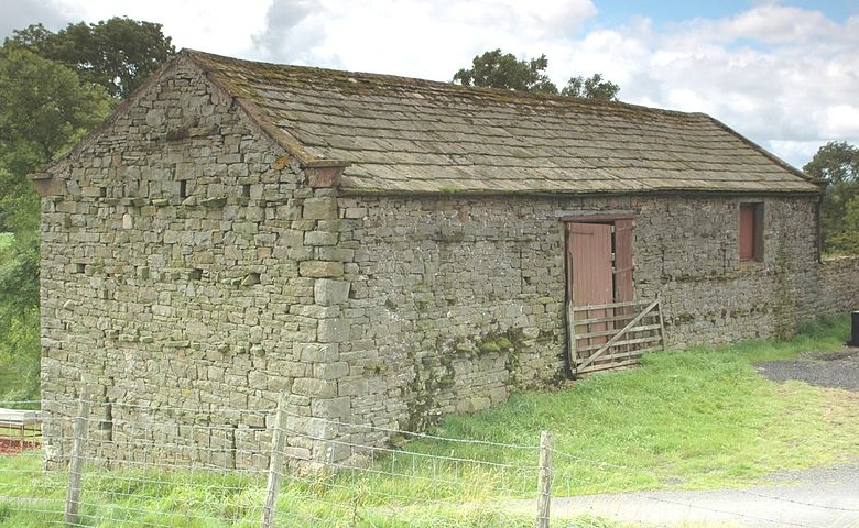 Upper view of stone bank barn in England