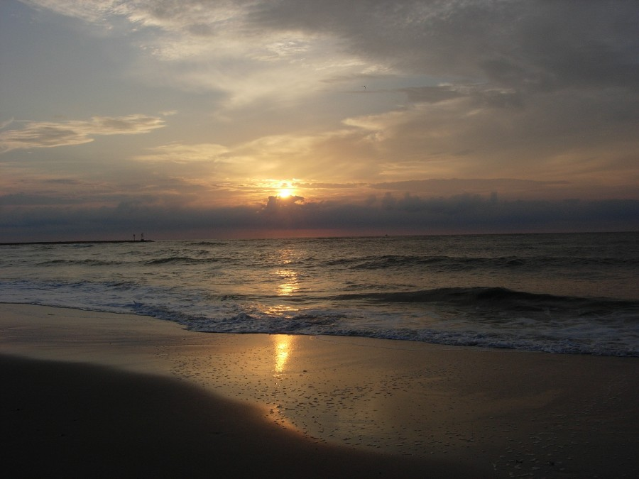 Photo of sun rising over surf, by the author